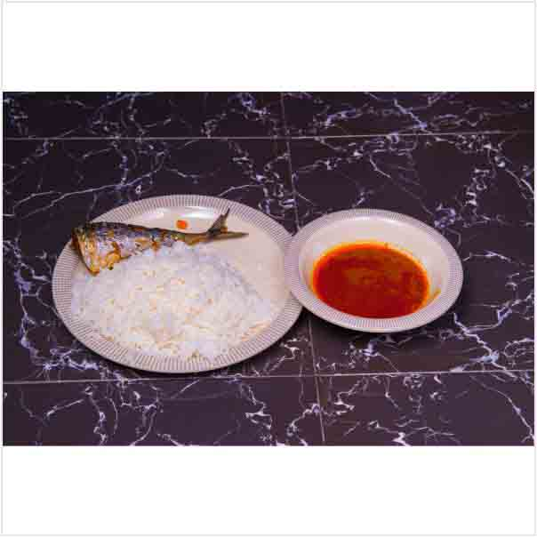 Tasty Delicious Hot White Rice and Stew With a well garnished Fish Tail. Get free water when you order for this item