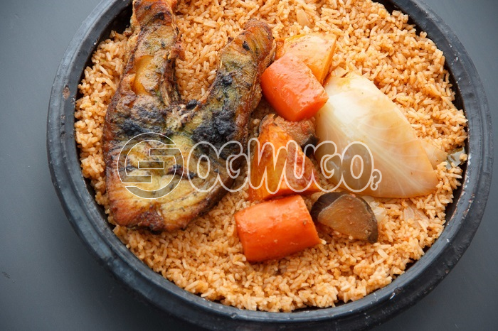 Hot Delicious savory Jollof Rice and FISH TAIL. The meal is very tasty just the way you like. Get free water when you order for this item