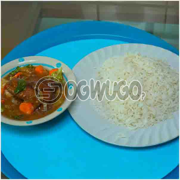 White rice and Chicken Sauce: A plate of Delicious Hot white rice with chicken sauce which can be enjoyed anytime of the day